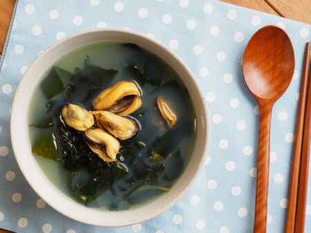 Korean food mussels seaweed soup Imagens