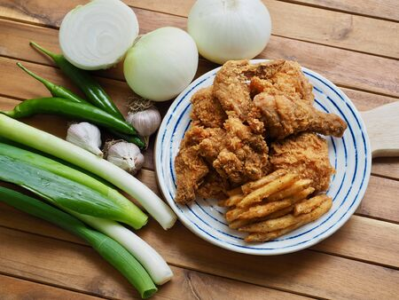 Fried chicken, French fries, Fresh organic vegetables, onion, wave, pepper, garlic Stock fotó