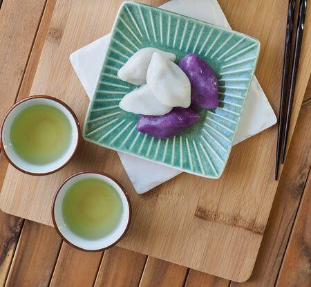 Korean food Songpyeon, half-moon-shaped rice cake with green tea Stock Photo