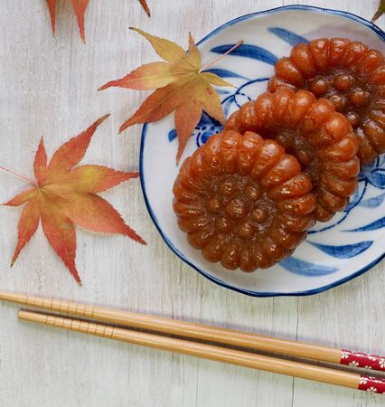 Korean traditional sweets Yakgwa (Honey Cookie) and Maple leaves
