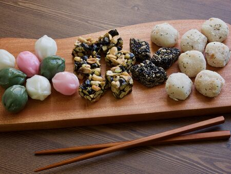 Korean traditional sweets and cookies, Honey rice cake, glutinous rice cake on wooden desk.