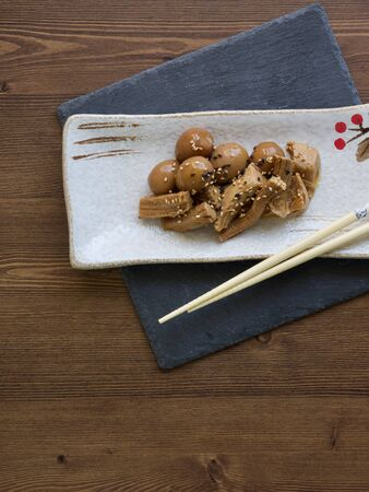 Asian food pork and quail eggs with soy sauce