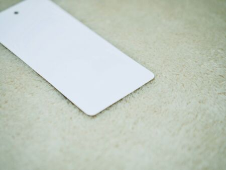 Close-up of microfiber cloth and Clothing label Stock Photo