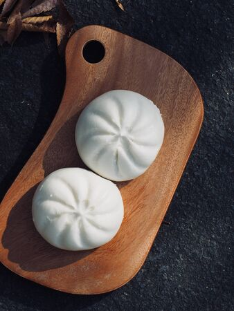 Asian food Steamed bun and fallen leaves