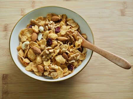 Spoon with cereal and nut mix
