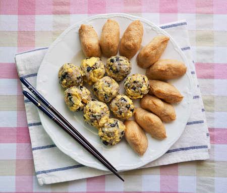 Asian food ham and vegetables rice balls and Yubu Sushi