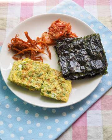 Korean side dish seaweed, egg roll, kimchi, squid