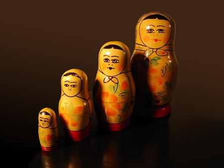 Four russian matryoshka on a brown background photo