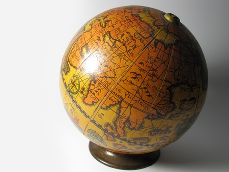 Old map ball of the world on a white background Stock Photo