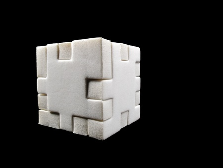 Puzzle cube white on a black background photo