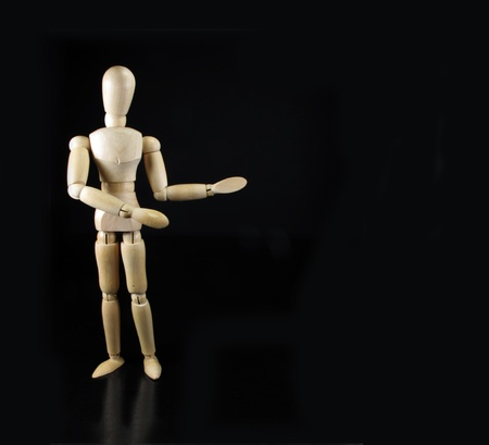a humanoid doll says something with a black background Stock Photo - 9457993