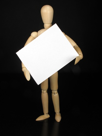 a humanoid doll with black background and white sign to write things Stock Photo - 9457994