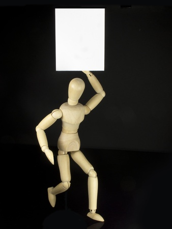 a humanoid doll with black background and white sign to write things photo
