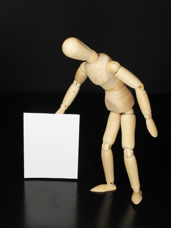 a humanoid doll with black background and white sign to write things Stock Photo - 9457997
