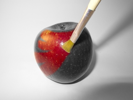 an apple red paint with a brush photo