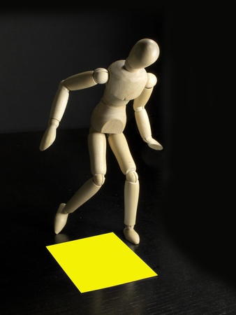 humanoid with a yellow sign on the floor by his feet photo