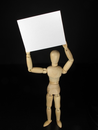 humanoid white poster holding it over his head Stock Photo - 9753796