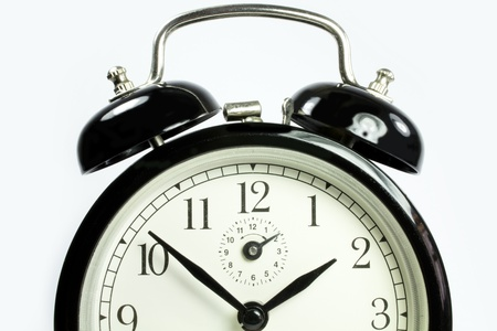 a front view of an antique clock on a white background black