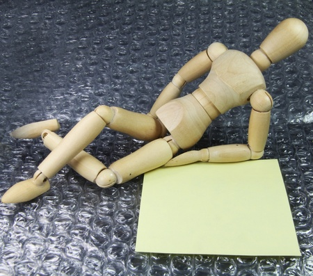 a Humanoid with a note lying on comfortable plastic bubbles photo