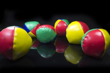 a set of juggling balls from the side view on a black background Stock Photo - 10097202