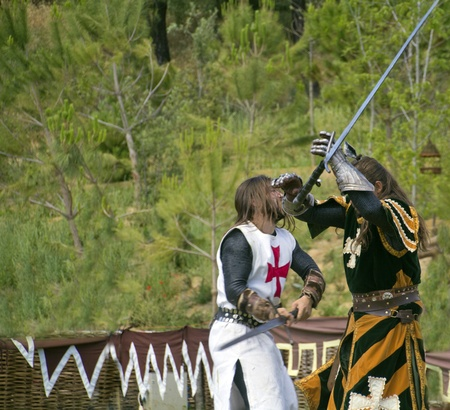 medieval knights fighting to the death with swords