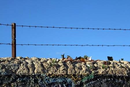 old wall with barbed wire and crystals photo
