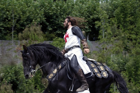 squire: medieval knight on his horse galloping Editorial