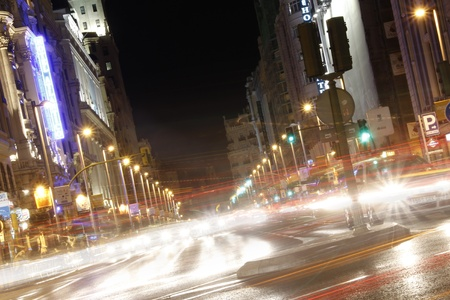 Famous and typical street of Gran Via in Madrid at night photo