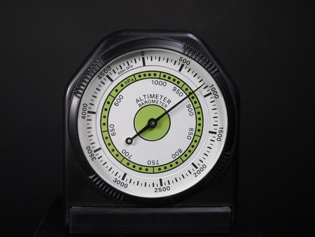 Altimeter barometer with based on a black background photo