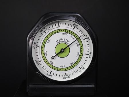 altimeter: Altimeter barometer with based on a black background Stock Photo