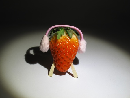 muffs: Strawberry wearing ear-muffs and its shadow