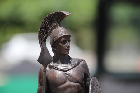 a foreground statue of a Roman warrior photo