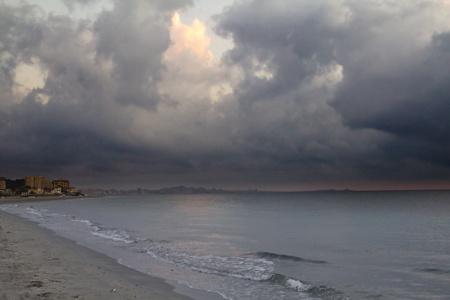 sunrise on the beach next storm photo