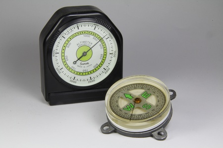 altimeter: barometric altimeter and compass on white background