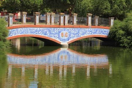 bridge over a tranquil lake photo