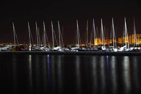 sailboats in the harbor at night Stock Photo