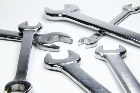 chrome wrenches on white background photo