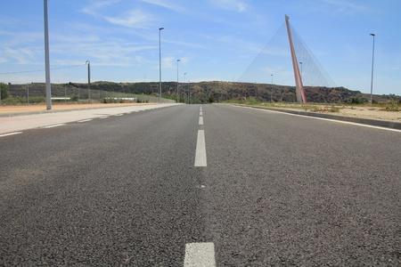 Straight tar road leading into photo