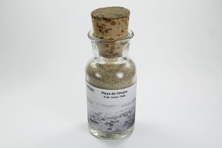 omaha: glass bottle with sand from Omaha Beach