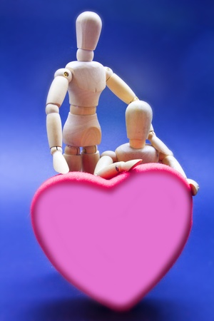 human's arm: Pair of expressing his love dolls Stock Photo