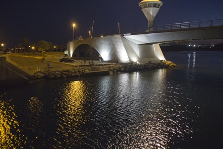 Drawbridge famous night in La Manga, Spain photo