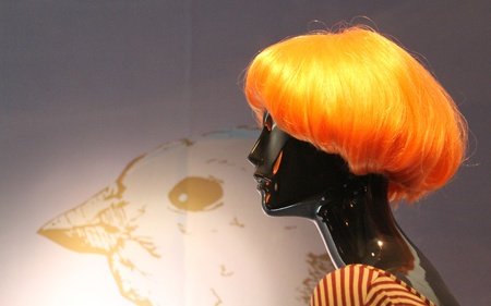 Female mannequin with very showy orange wig photo
