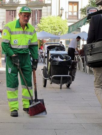 a Sweeper cleaning service worker of the City of Madrid Editorial