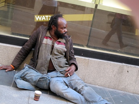 a beggar on a street in Madrid Spain