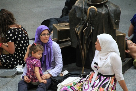 Madrid - OCT 20: Muslim woman with her daughter on OCT 20, 2011 in Madrid Spain Editorial