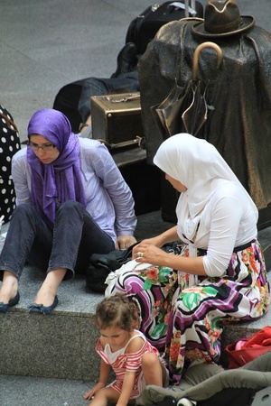 Madrid - OCT 20: Muslim woman with her daughter on OCT 20, 2011 in Madrid Spain