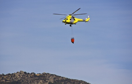 fire fighting helicopters fire on the mountain photo
