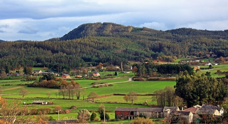 landscape of green hills in galicia, spain photo