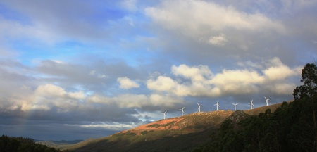 eolian: forested mountains with clouds and windmills eolian