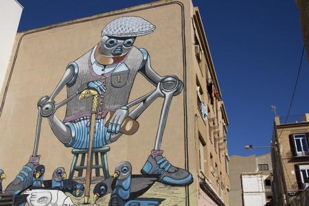 asbo: giant robot graffiti on the facade of a house